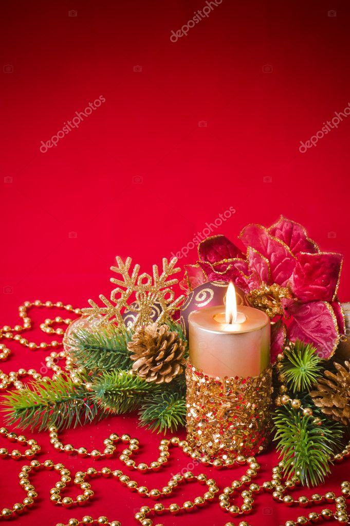Burning  candle amongst green fir branches,  Christmas concept — Stock Photo #4421209