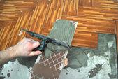 Laying tiles — Stock Photo