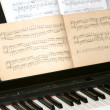 Piano and notes — Stock Photo