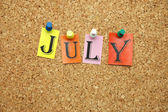 July on board — Stock Photo