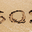 Stock Photo: Sos in sand