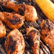 Chicken legs on grill - Stockfoto