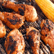 Chicken legs on grill - Stock Photo