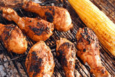 Chicken legs on grill — Stok fotoğraf