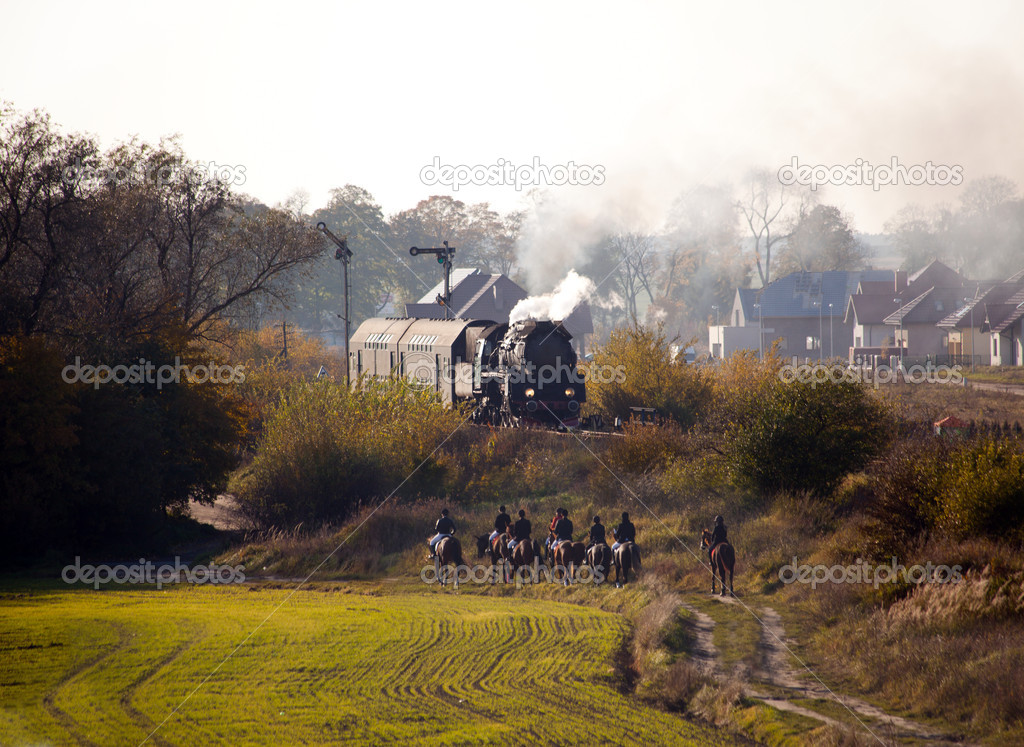 Old retro steam train passing through polish countryside — Stock Photo #4097801