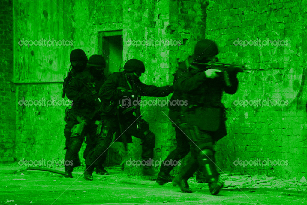 Subdivision anti-terrorist police during a black tactical exercises. Entry to the premises. Real situation. View through the night vision device.   Stock Photo #4628831