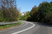 Empty curved road,blue sky — Stock Photo