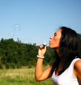 Girl making soap bubbles — Stock Photo