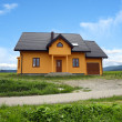 New house in country landscape — Stockfoto