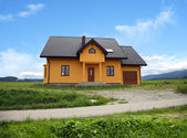 New house in country landscape — Stock Photo