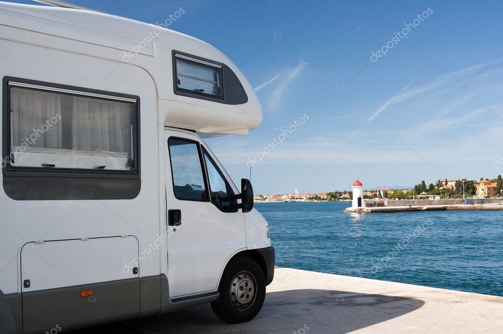 Truck trailer over sea — Stock Photo #4388380