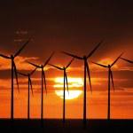 Wind turbine farm over sunset — Stock Photo #4444082