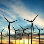 Wind turbines farm at sunset — Stock Photo