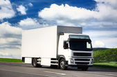 White truck driving on a road — Stock Photo
