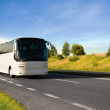 Tourist bus traveling down a major highway — Stock Photo