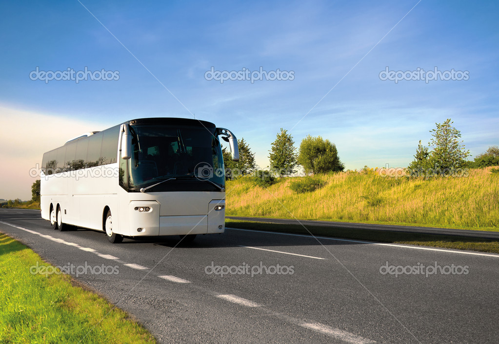 Tourist bus traveling down a major highway — ストック写真 #5128536