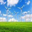 Alternative clean power wind turbines in field — Stock Photo