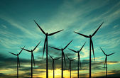 Wind turbine farm over sunset — Stock Photo