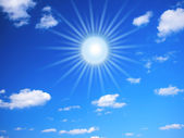 Bright summer sun and clouds — Stock Photo