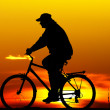Biker silhouette at sunset — Stock Photo
