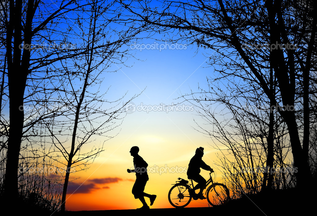 Recreation, jogging and cycling at sunset  Stock Photo #3976112