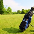 Golf equipment on green field — Stok fotoğraf