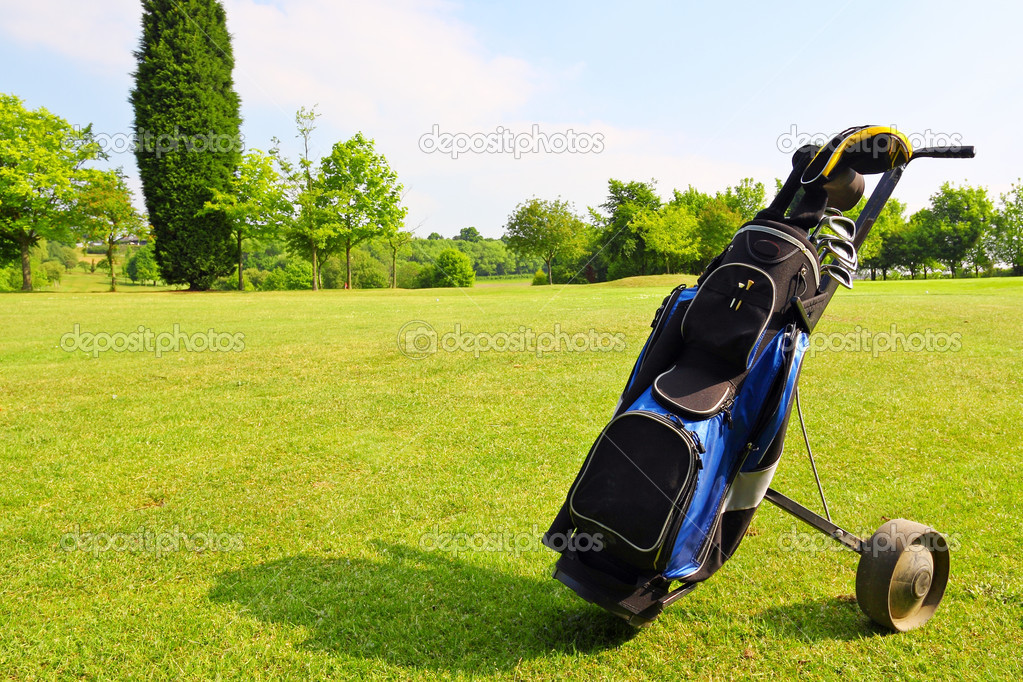 Golf equipment on green field — Stock Photo #4185505