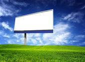 Big billboard over blue sky — Stock Photo