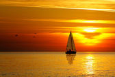 Drifting boat on a sunset — Stock Photo