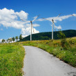 Country mountain road and wind turbines — Stock Photo #4756216