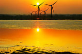 Gold liquid and wind turbines — 图库照片
