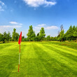 Golf course and blue sky - Stock Photo