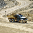 Transport trucks in the dolomite mine - Stock Photo