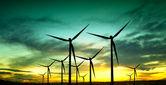Silueta de turbinas de viento al atardecer — Foto de Stock