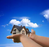 House in my hands — Stock Photo