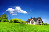 Eco House on a green hill — Stock Photo