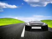 Sports car moving on the mountain road — Stock Photo