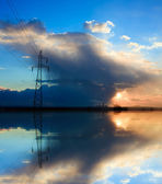 Blue power, high voltage electricity pylon over sunset — Stock Photo
