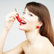 Royalty-Free Stock Photo: Sexy woman biting a chili pepper