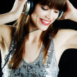 Cheerful woman with headphones — Stock Photo