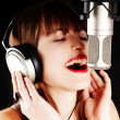 Girl singing to the microphone in a studio — Stock Photo #5259666