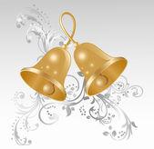Twee gouden handbellen — Stockvector