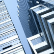 View of modern blue colored building on blue sky back — Stock Photo #5241212
