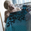 Portrait of young beautiful woman checking new dress in the store — Foto Stock