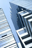 View of modern blue colored building on blue sky back — Stock Photo