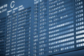 Close up view of airport time-table blue toned — Stock Photo