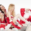 SantClaus with two sexy helpers in his office — Stockfoto #4500219