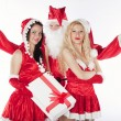 Santa Claus with two sexy helpers in his office — Stock Photo #4500224