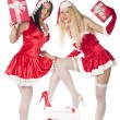 Stock Photo: Two sexy Santgirls having fun on Christmas party