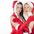 Two sexy Santa girls having fun on a Christmas party — Стоковая фотография
